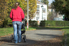 Walking with baby carriage Royalty Free Stock Photo