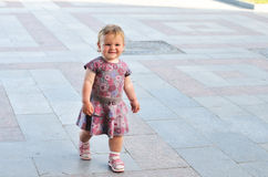 Walking baby girl Stock Photo