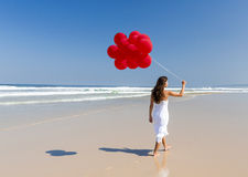 Walking with ballons Royalty Free Stock Image