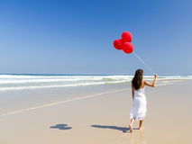 Walking with ballons Royalty Free Stock Photo