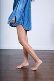 Walking barefoot with denim shirt Royalty Free Stock Photography