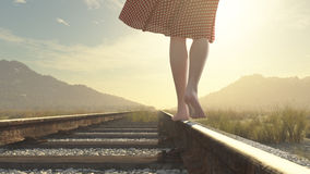 A walking barefoot girl on the railway Royalty Free Stock Photography