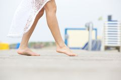Walking barefoot outdoors Stock Photos