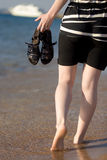 Walking barefoot through the surf Royalty Free Stock Photo