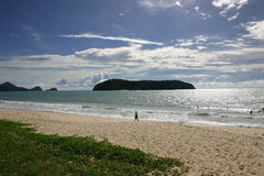 Walking on the beach. Walk in the tropical paradise of Langkawi - Malaysia Royalty Free Stock Photos