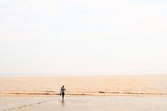 Walking on a beach Stock Photography