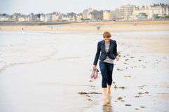 Walking on the beach Royalty Free Stock Photography
