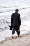 Walking on beach. Old man walking on beach Royalty Free Stock Photography
