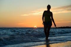 Walking on beach Stock Image
