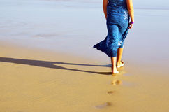 Walking on the beach Royalty Free Stock Images
