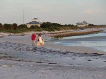 A family walking on the beach. A family walking on Honeymoon Island Beach in Dunedin Florida stock images