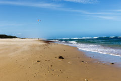 Walking on the beach. With a rough sea on the side Royalty Free Stock Photo