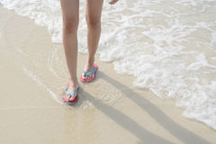 Walking on the beach. And sea Royalty Free Stock Photo