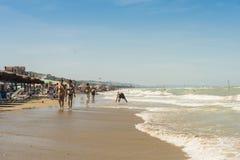 Walking on the beach at Silvi Marina Italy. People walking on the sand beach at Silvi Marina beach in Abruzzo, Italy Stock Photography