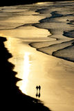 Walking on the beach with sunset light Royalty Free Stock Photo