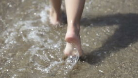Walking on the beach stock video footage