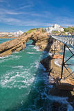 Walking on beautiful footbridge leading to rocher de la vierge on atlantic coastline with cliffs and turquoise ocean in biarritz, Stock Photos