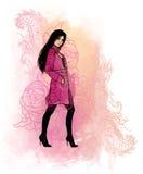 Walking beautiful girl wearing pink coat Royalty Free Stock Photo