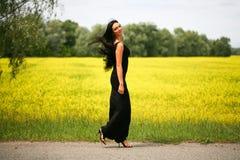 Walking beautiful young woman Stock Image