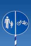 Walking and bicycle road sign shared use path Royalty Free Stock Photos