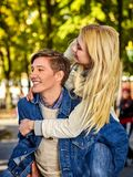 Walking bike of couple in park and kissing walk outdoor. Walking bike of couple in park and kissing. Autumn friends walk outdoor. First date of two young people Royalty Free Stock Images