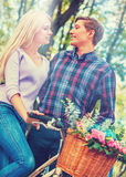Walking bike of couple in park and kissing walk outdoor. Walking bike of couple in park and kissing. Summer friends walk outdoor. First date of two young people Stock Image