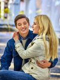 Walking bike of couple in park and kissing walk outdoor. Walking bike of couple in park and kissing. Autumn friends walk outdoor. First date of two young people Stock Photos