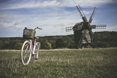 Walking bike, a sunny day. mill and field Stock Images