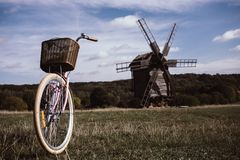 Walking bike, a sunny day. mill and field Stock Photo