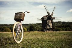 Walking bike, a sunny day. mill and field stock photos