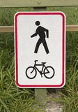 Walking / Biking Track Sign. A sign for a walking and biking track Royalty Free Stock Photography