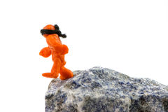 Walking blind on the brink. Self-made human plasticine figure walking to the edge of the abyss Royalty Free Stock Photography