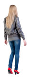 Walking blonde woman Stock Photo