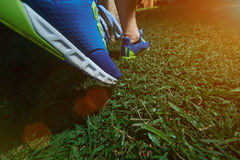 Walking on blue run shoes Royalty Free Stock Images