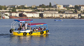 The walking boat at excursion on city bays. Sevastopol. Ukraine.- Sentember19:The walking boat at excursion on city bays. Sentember-19.2012 in Sevastopol Stock Images