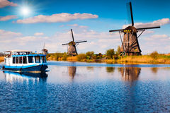 Walking boat on the famous Kinderdijk canal with windmills Stock Images