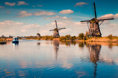Walking boat on the famoust Kinderdijk canal with windmills. Royalty Free Stock Photo