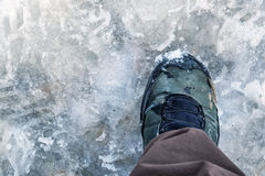 Walking boot on slush Royalty Free Stock Images