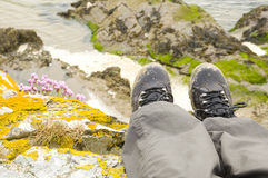 Walking boots with beach in background Royalty Free Stock Photos