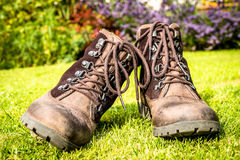 Walking Boots with Eyelet Laces. A pair of brown, well worn, waterproof, leather walking boots with an eyelet and laces closure royalty free stock photo