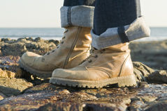 Walking boots on rocks Royalty Free Stock Photo