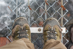 Walking boots on suspension bridge Royalty Free Stock Image