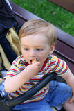 Walking boy   eats biscuits Stock Image