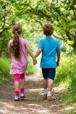 Walking boy and girl Royalty Free Stock Photos