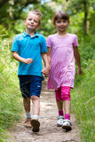 Walking boy and girl Stock Images