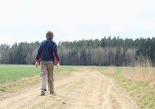 Walking boy Stock Images