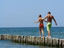 Walking on breakwater Stock Photography