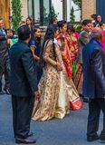 Walking with the Bride. ATLANTA, GEORGIA - August 19, 2018: Indian weddings last an average of 3 days. Part of the ceremony is the baraat, or groom`s procession royalty free stock photography