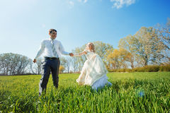 Walking bride and groom Stock Photo