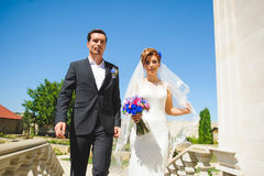 Walking Bride and Groom Royalty Free Stock Photo